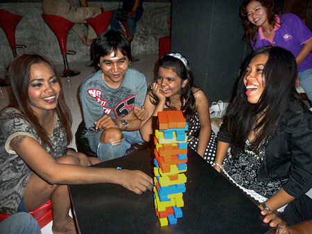 Some of the girls who run the Phuket Backpackers Hostel enjoy their annual staff party in Phuket Town, Thailand.