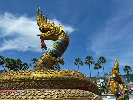 A golden dragon sunbathes on Karon beach in Phuket, Thailand.