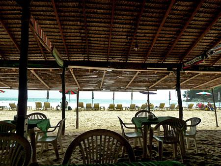 A view of the beach from a restaurant hut at Laem Singh, Phuket, Thailand.