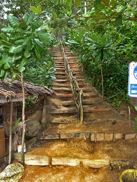 Looking up the rustic dirt stairs at Laem Singh, Phuket, Thailand.