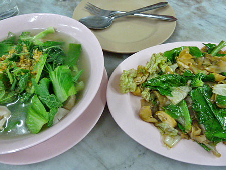 Some serious leafy greens and curry noodles for dinner in Phuket Town, Thailand.
