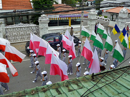 The flag wavers at a school parade in Phuket Town, Thailand.