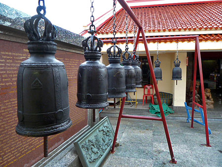 Racks of bells at Put Jaw Temple in Phuket Town, Thailand.