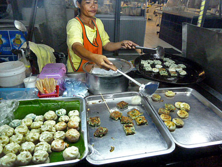 This lady is frying up some delicious veggie cakes in Phuket Town, Thailand.