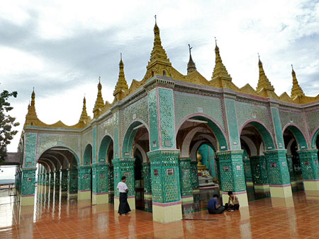 A Buddhist shrine gets fancy on top of Mandalay Hill, Myanmar.