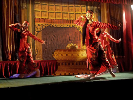 A traditional Burmese dance at Mintha Theater in Mandalay, Myanmar.