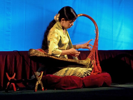 A solo harp performance at Mintha Theater in Mandalay, Myanmar.