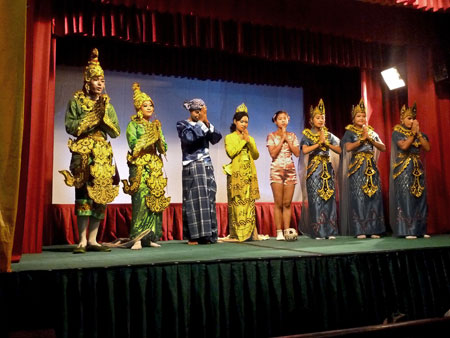 Traditional Burmese dancers at Mintha Theater in Mandalay, Myanmar.