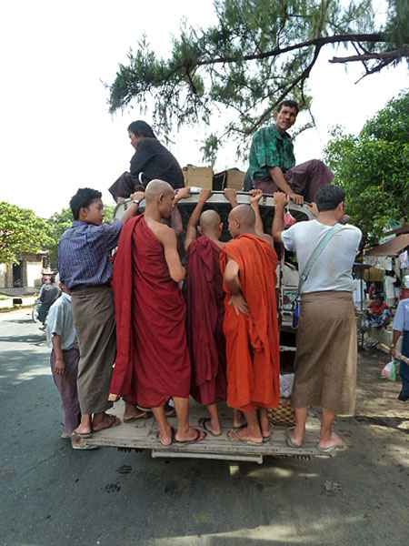 Buddhist monks on the go, take two, in Mandalay, Myanmar.