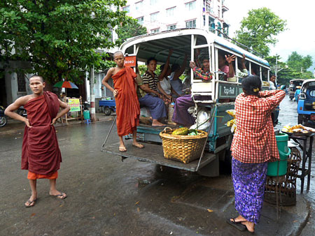 Buddhist monks on the go in Mandalay, Myanmar.