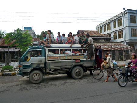 Rooftop riders in Mandalay, Myanmar.