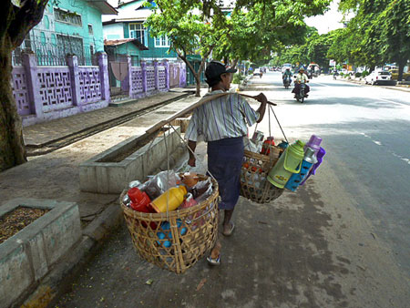 The Bottle Man knows his way around town in Mandalay, Myanmar.