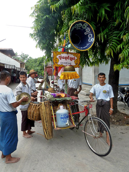A street procession band called Thone Yaung Chael kicks up a ruckus in Mandalay, Myanmar.