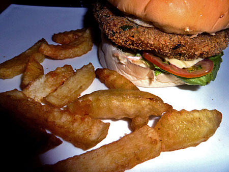 A veggie burger and seven or eight fries at V Cafe in Mandalay, Myanmar.