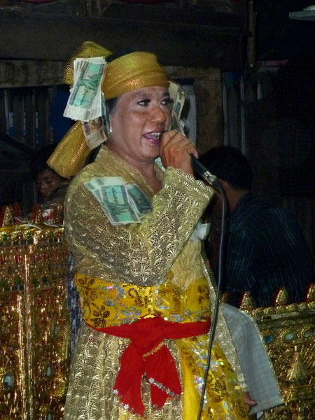 A nat kadaw commands the mic at the nat pwe in Taungbyone, Myanmar.