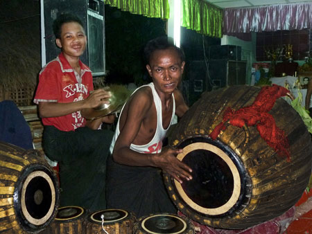 A cymbal player and a drummer beat time and increase the heat at the nat pwe in Taungbyone, Myanmar.