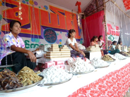 Ladies all posted up and selling sweets at the nat pwe in Taungbyone, Myanmar.