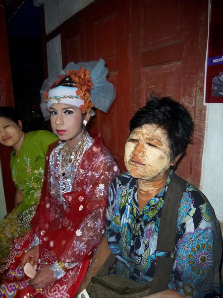 A nat kadaw and thanaka paste-covered woman make quite a pair at the nat pwe in Taungbyone, Myanmar.