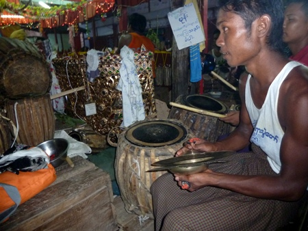 Close-up on another cymbal player and a drummer at the nat pwe in Taungbyone, Myanmar.