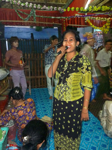 A singer gives me a big smile during the nat pwe in Taungbyone, Myanmar.