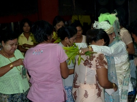 A nat kadaw performs services for a congregation at the nat pwe in Taungbyone, Myanmar.