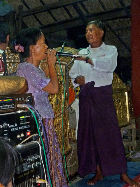 A little lady belts out a big tune at the nat pwe in Taungbyone, Myanmar.