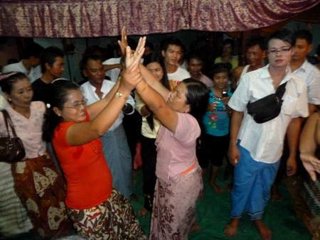 Nat worshippers engage in an ecstatic trance dance at the nat pwe in Taungbyone, Myanmar.