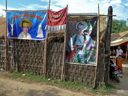Posters announcing upcoming services of nat kadaws at the nat pwe in Taungbyone, Myanmar.