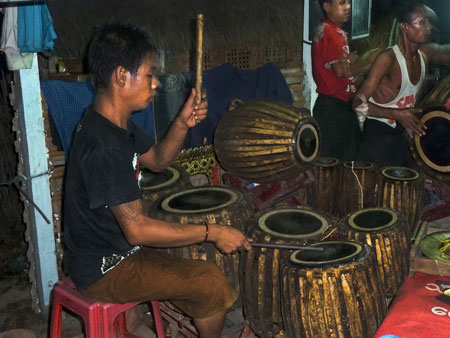 A chauk lone bat drummer wails the night away at the nat pwe in Taungbyone, Myanmar.