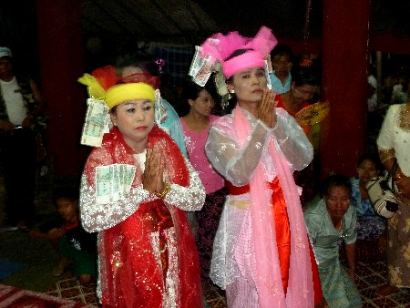 Two nat kadaws perform services at the nat pwe in Taungbyone, Myanmar.