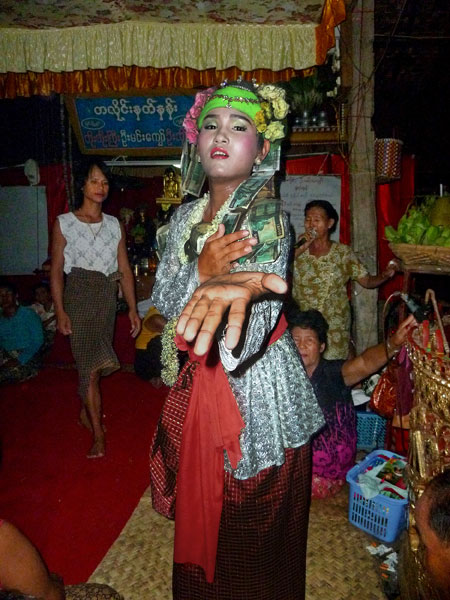 It doesn't get any more stylish than this! A nat kadaw busts a move in front of the faithful at the nat pwe in Taungbyone, Myanmar.