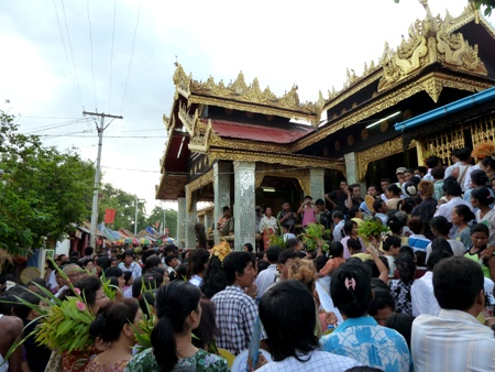 The main temple gets overwhelmed by a frenzy of the faithful at the nat pwe in Taungbyone, Myanmar.