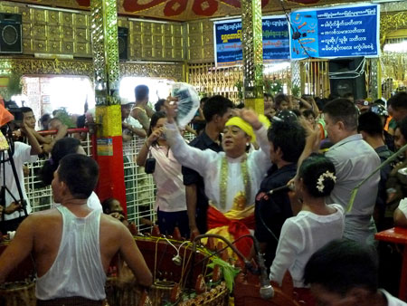 A nat kadaw performs his services in the main temple at the nat pwe in Taungbyone, Myanmar.