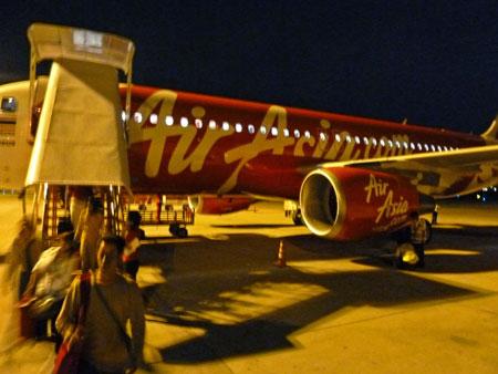 Disembarking from an Air Asia jet in Bangkok, Thailand.