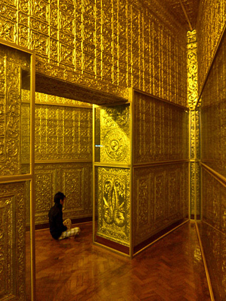 All gold, all the time! Meditating youth in the pizza slice-shaped chambers at Botataung Pagoda in Yangon, Myanmar.