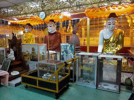 A triple-Buddha shrine at Botataung Pagoda in Yangon, Myanmar.