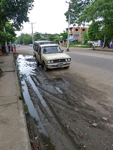 Just your average muddy gutter in Yangon, Myanmar.