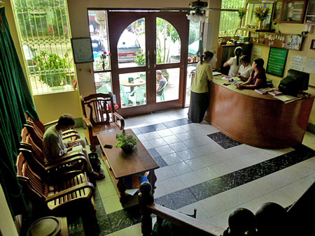 The air-conditioned lobby of the Motherland II Inn in Yangon, Myanmar. Please install some cushions on those chairs.