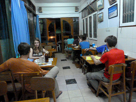 A busy night in the cafe at the Motherland Inn II in Yangon, Myanmar.