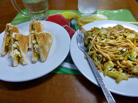 An egg sandwich and noodles at the Motherland Inn II in Yangon, Myanmar.