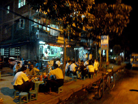 Yangon, Myanmar: A fine place for grown men to sit on tiny plastic chairs and tables designed for midgets.