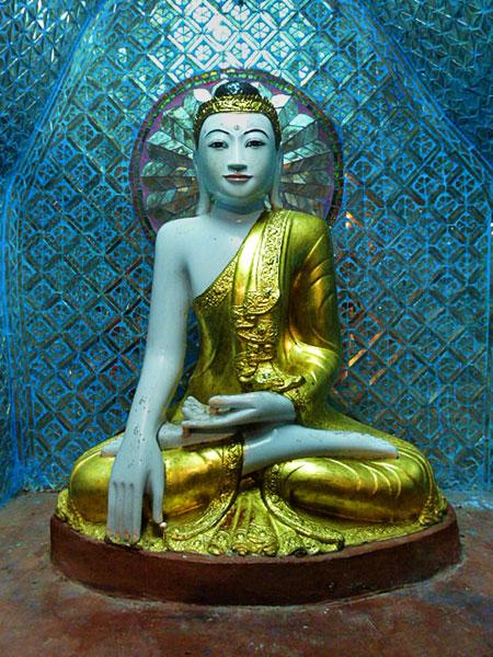 A radiant Buddha image at Shwedagon Pagoda in Yangon, Myanmar.