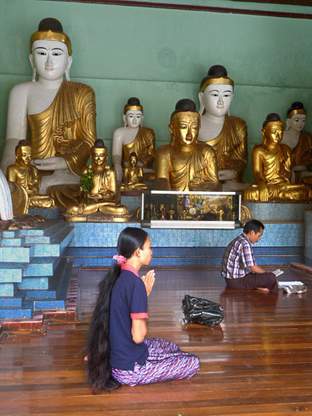 Long hairs and solemn prayers go well together in Shwedagon Pagoda in Yangon, Myanmar.