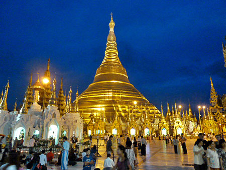 Bathed in electric light just after sundown, Shwedagon Pagoda shows off all of its golden glory in Yangon, Myanmar.