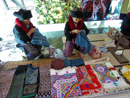 A living, breathing, working Thai hill tribe display at Bangkok's Suvarnabhumi airport.