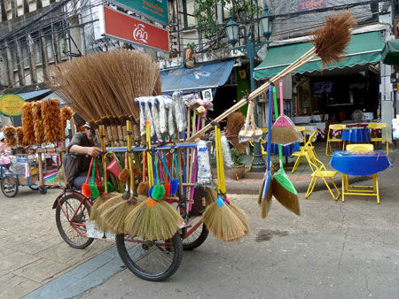 Food carts are everywhere in Bangkok, which makes this rare sighting of the ever-elusive broom cart all the more special. Thanon Khao San, Banglamphu, Bangkok, Thailand.