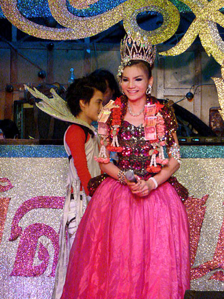 A queen enjoys her time in the spotlight at a ladyboy cabaret in Bangkok, Thailand.
