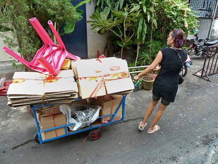 A cardboard cartist plies the back alleys of Banglamphu, Bangkok, Thailand.