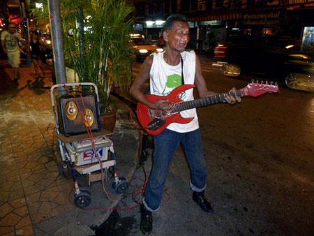 A dirty fuzz rocker near Thanon Khao San in Banglamphu, Bangkok, Thailand.