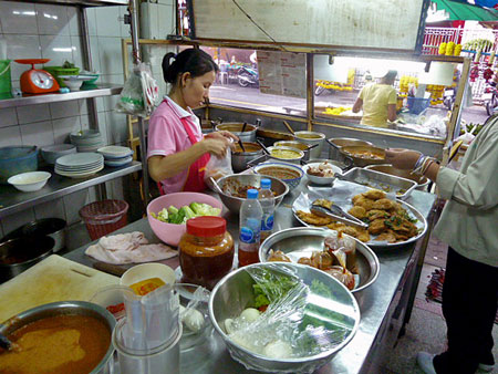 A cook hard at work at Krua Aroy-Aroy in Bangkok, Thailand.